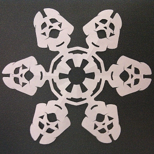 Paper snowflake with the likeness of Darth Vader's head at the end of each 'spoke'