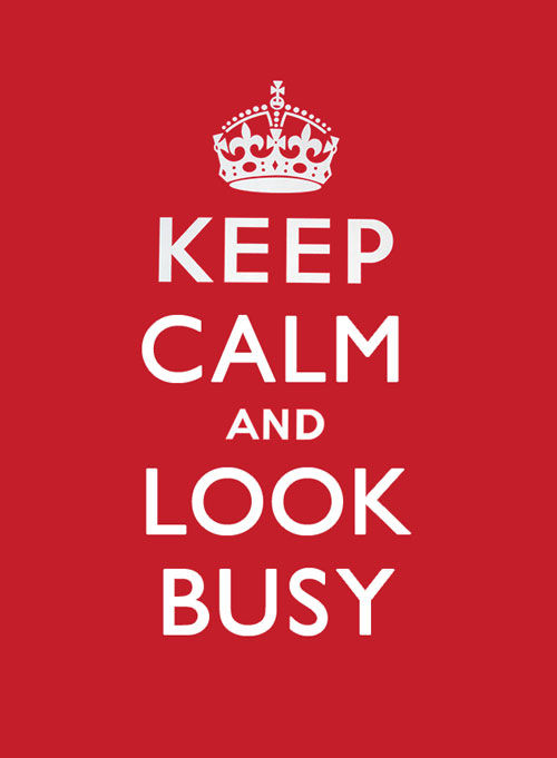 "Image with pink background and white text, in the style of the British WW1 ""Keep Calm and Carry On"" poster.  Text reads ""Keep Calm and Look Busy""."